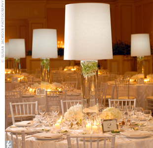 Glowing lampshades were held up by tall glass cases filled with water and submerged orchids.