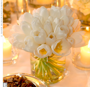 Low arrangements of white tulips along with votives surrounded the tall lamps on the tables.