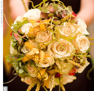 Dried wheat grass and curly willow mixed in with more traditional wedding flowers -- hydrangeas, roses, cymbidium orchids -- gave the bouquets a nice fall feel.