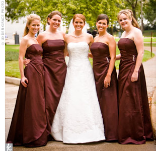 The bridesmaids wore deep brown asymmetrically gathered gowns pinned with rhinestone brooches at the waist.
