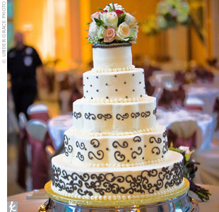 For Shannon, the cake was one of the most important parts of the wedding -- it had to taste delicious. The five-tiered cake was frosted in French vanilla buttercream and decorated with piped chocolate embellishments.