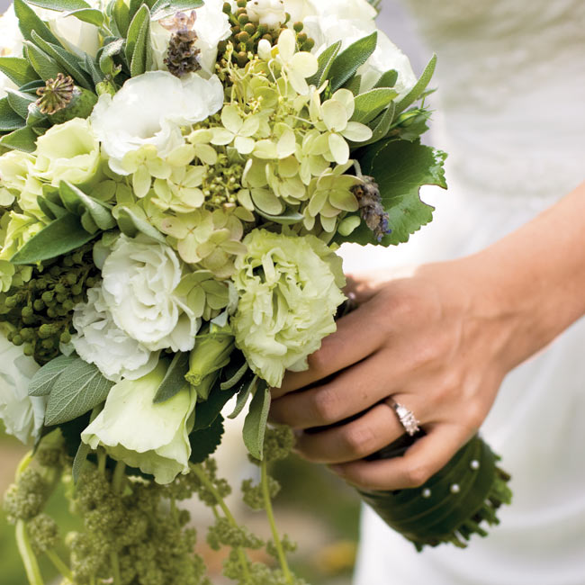 Lauren carried a hand-tied bouquet of white and green lisianthuses, miniature green poppy pods, rosemary, sage, green hydrangeas, fresh lavender, and hanging green amaranthus.