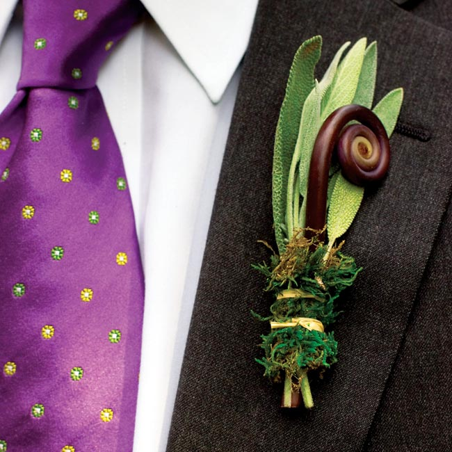 Josh sported a boutonniere of rosemary, sage, and poppy pods wrapped with moss and raffia. The dads and groomsmen each wore a fiddlehead fern accented with rosemary.