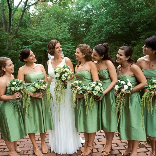 Lauren's maids wore meadow green, silk dupioni, knee-length dresses by Ann Taylor Celebrations. Her sister, the maid of honor, wore a slightly different style with chiffon at the hem.