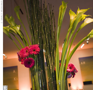 Gerbera daisies, calla lilies, and bamboo gave the tabletops  dramatic height.