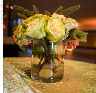 Our designers added elegant and earthy arrangements to the mix. River rock-lined clear vases filled with luscious roses fit right in with the surrounding works of art.