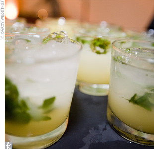 Guests sipped mixed drinks garnished with fresh mint.