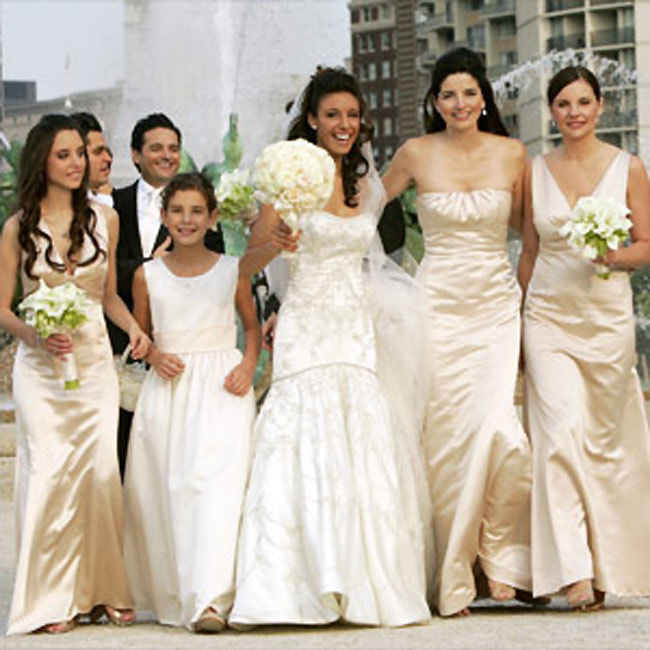 The bridesmaids -- Alexis' sister and the groom's sister and sister-in-law -- wore champagne-colored dresses in a variety of styles from Vera Wang Maids.