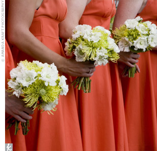 Bridesmaids carried large lime green spider mums and white scabiosa tied with madras-patterned dupioni ribbon in orange, yellow and green.