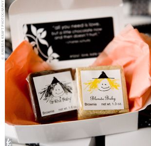 Guests received boxes with chocolate and blonde mini brownies from the couple's favorite bakery. The brownies were wrapped in tangerine tissue paper and placed in white boxes tied with a variety of black and white ribbons.