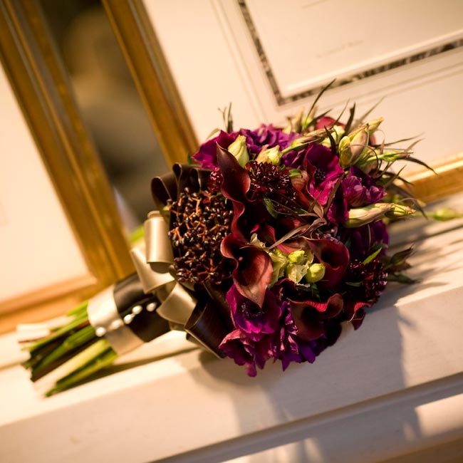 Deb carried purple lisianthuses, anemones, and pansies with black privet berries, all wrapped in a ribbon the same shade of green as the sash on her gown.