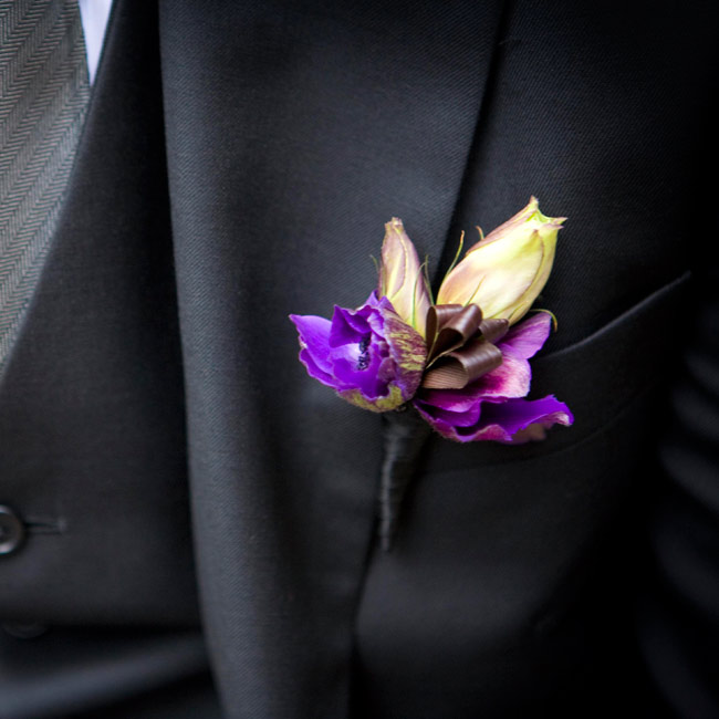 Jim wore a purple lisianthus wrapped in black ribbon on his lapel.