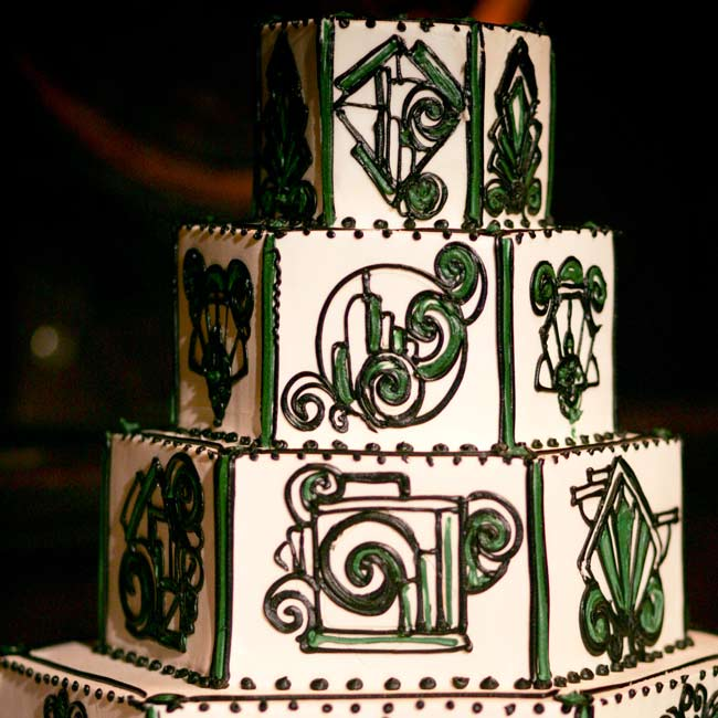 The four-tiered cake alternated between red velvet cake with cream cheese filling and chocolate devil's food cake with fudge filling. Fondant icing in black and green featured an art deco design.