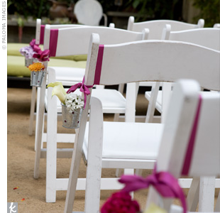The ceremony was held in the small garden in front of a fountain draped with flowers and surrounded by candles.  The mother of the bride had filled galvanized buckets with flowers and placed them on the chairs that lined the aisle.