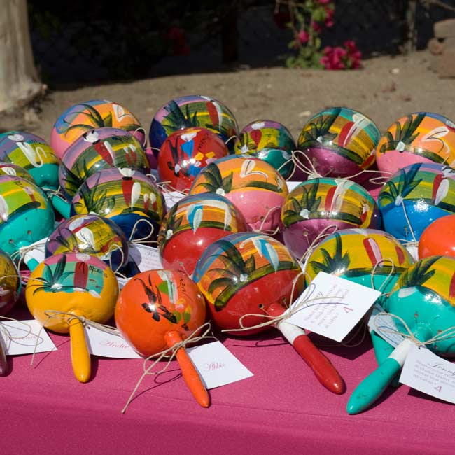 As guests entered through the front into the main room, they were greeted by a table of maracas.  Each maraca had a guest's name, a table number, and a poem about shaking their maracas. These doubled as the wedding favors.