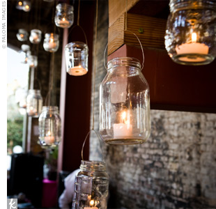 Mason jars filled with candles emitted a soft light along the stairway inside the reception site.