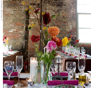 Courtney purchased about 50 old Spanish vinegar jars and arranged them in the center of each table in groups of five with two or three stems each of dahlias, ranunculuses, kangaroo paws, spider mums, or billy balls.