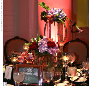 Glass and mirror mosaic candleholders surrounded the centerpieces -- glam vases with orchids, roses, and calla lilies.