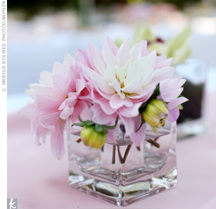 Individual tiny square glass vases filled with pink dahlia's decorated the tables.