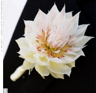 Adding a touch of pink to his black tuxedo, the groom wore a single dendrobium orchid.
