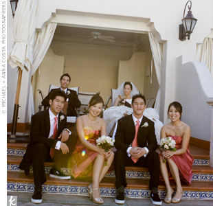 Lisa's one bridesmaid and maid of honor wore strapless, knee-length dresses in coral. The groomsmen looked mod in their Kenneth Cole black suits with coral ties and black Vans sneakers.