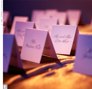 Each tented escort card was hand-calligraphed and studded with a single pink rhinestone.