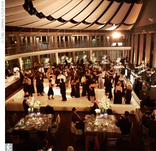 The couple chose Ahmanson Hall at The Skirball Cultural Center because they loved the floor-to-ceiling windows and vaulted wind-sail-like ceiling.