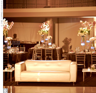 The couple wanted a lounge feel where guests could mingle so they surrounded the dance floor with white leather sofas and benches.