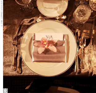 A blush cymbidium orchid gave the white chargers and slate napkins a boost of color.