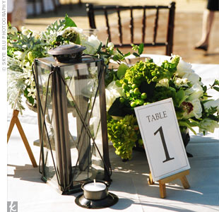 Floral Arrangements with Lanterns http://www.theknot.com/weddings/album/sara-and-austin-an-outdoor-wedding-in-santa-barbara-ca-38151
