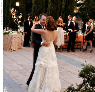 """Although they chose a classical guitarist for the ceremony, the couple livened things up at the reception by sharing their fist dance to """"Beautiful"""" by the Smashing Pumpkins."""