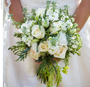 Joni's bouquet was comprised of all white roses and accented with greenery to add texture to the design.