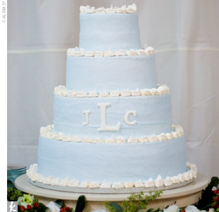 Joni and Chip cut into a four-tiered buttercream cake that was frosted in pale blue and decorated with their monogram. Inside, the cake was made of white cake, pound cake, and key lime.