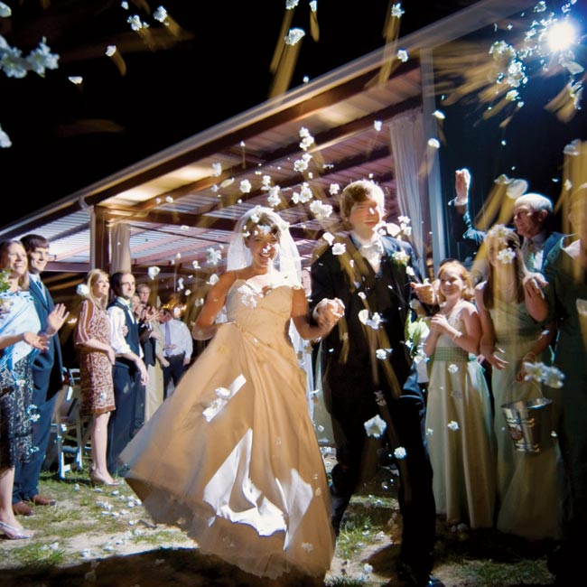 Guests tossed white flower petals as the newlyweds made their escape at the end of the evening.