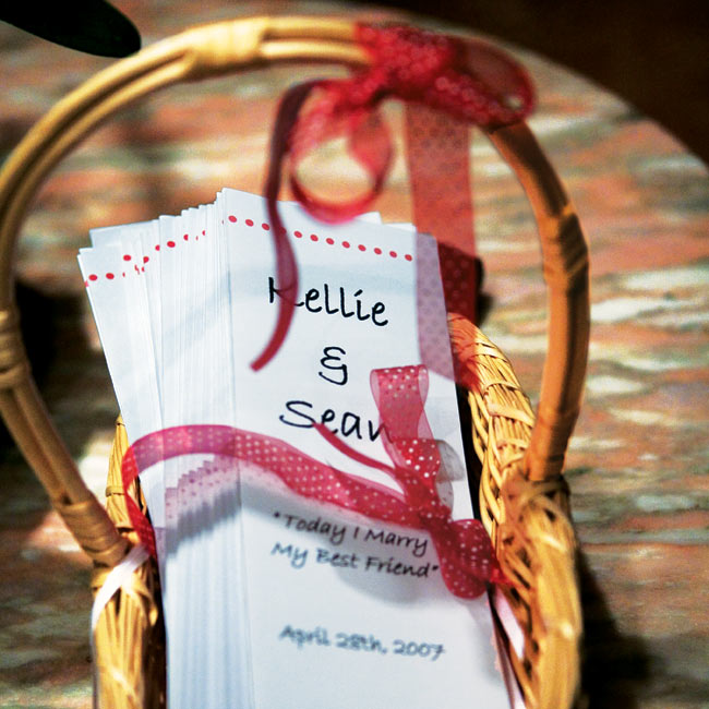 Kellie made the programs for the ceremony, which were printed on white paper and featured the couple's red and white, polka dot motif.