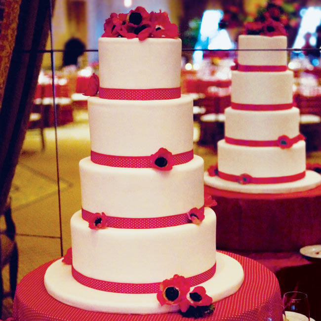 The four-tiered cake epitomized old Hollywood glamour: each tier was trimmed with a red fondant band and accented with red anemone flowers.