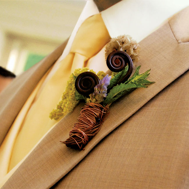 Christopher's boutonniere was a cluster of fiddlehead ferns, scabiosa pods, and green amaranthus mixed with mint and lavender and wrapped in brown raffia and copper wire.