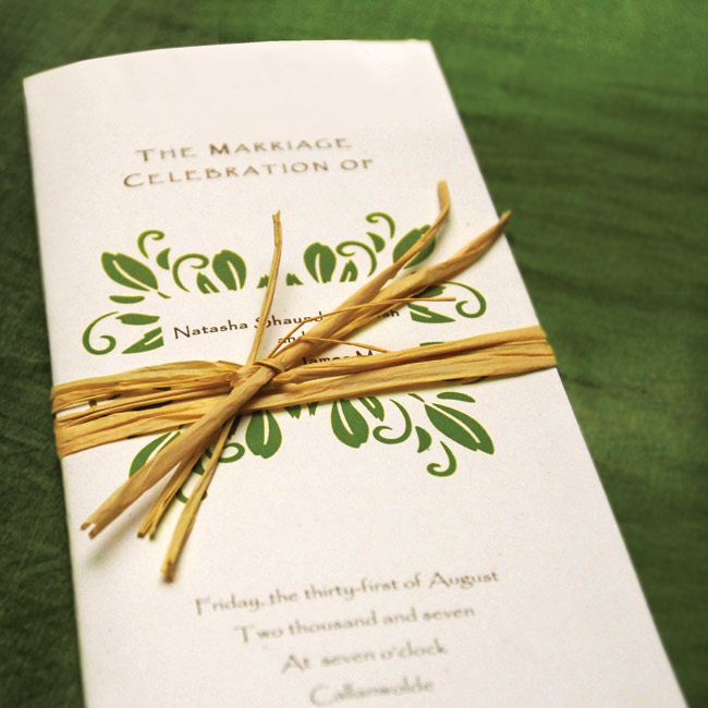 The ceremony programs were printed with a green leaf motif, along with brown and green lettering to coordinate with the colors of the day. The couple also included a paragraph on the broom jumping ceremony, as well as quotes that were meaningful to the couple.