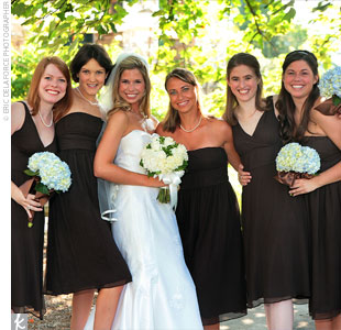 Anna&#39;s five bridesmaids wore black knee-length dresses in various styles from J.Crew and carried clusters of blue hydrangeas, which were hand-tied with brown ribbon.