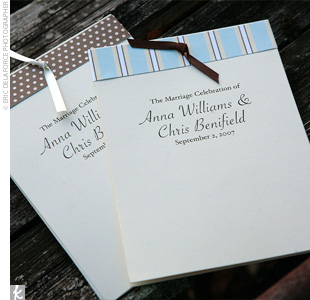 As a graphic designer, Anna enjoyed creating all the wedding day stationery. The programs were simple white cards accented with brown and blue-patterned paper and tied off with a brown ribbon.