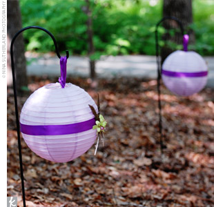 Shepherd's hooks, which held purple lanterns and were accented with deep purple ribbon, lined the pathways outside the reception space.