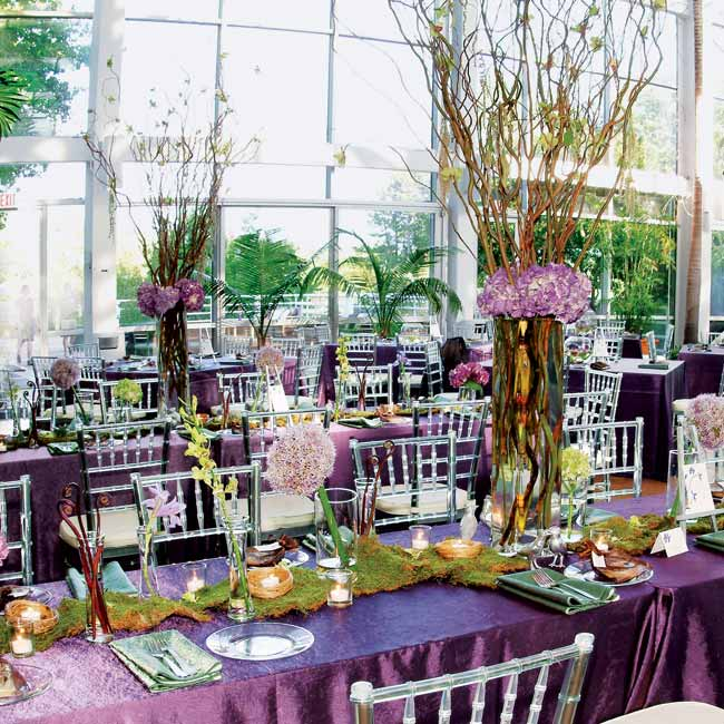 Two estate tables that seated the couple and their families featured a variety of arrangements with curly willows and blossoms.