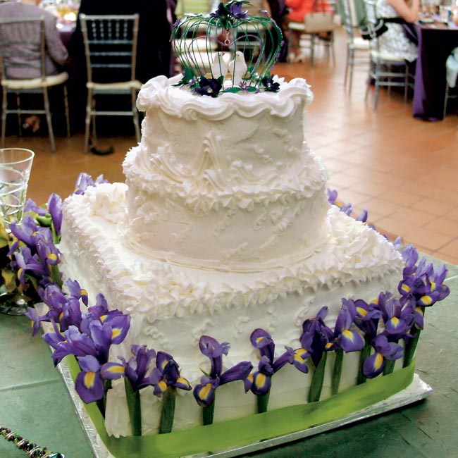 Bethany and Doug went with a classic white wedding cake covered in buttercream. The bottom tier tied in the colors of the day and was accented with irises and a green ribbon.