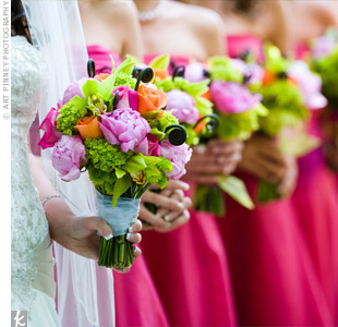 The bride's favorite colors -- pink and green -- popped in bouquets of lime green hydrangeas and button mums, pink peonies, roses and fiddlehead ferns.