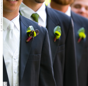 Kermit mums and fiddlehead ferns decorated the lapels of the groom and groomsmen.