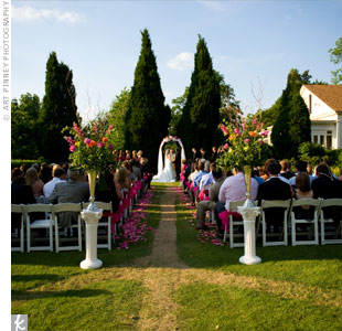 The couple exchanged vows beneath an organza-covered arch at the Brumby Hall Perennial Garden.