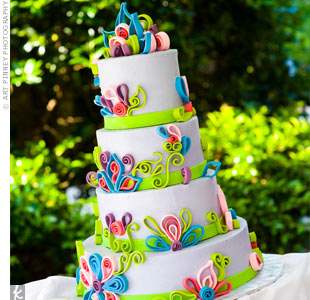 Light purple fondant and fuchsia, blue and purple art-deco flowers decorated the four-tiered cake.