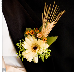 A white gerbera daisy, seeded eucalyptus and wheat were pinned to the groom's lapel.