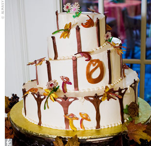Gum paste and white chocolate dragonflies, turtles, leaves and flowers created an art nouveau design on the three-tiered, spiraled, buttercream-iced cake.