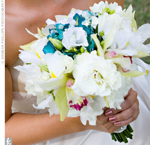 Pink bursts from orchids and blue tones from hydrangeas stood out against Shelby's hand-tied bouquet of mostly white flowers.
